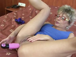 Blonde granny is wearing glasses while having anal sexual connection all over a handsome, black man she likes