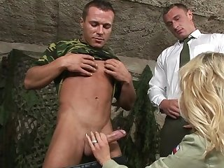 Army dudes share this fine ass blonde in a very intriguing manner