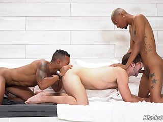 Black hunks are enjoying twink lousy with venal threesome