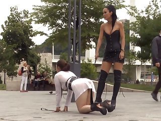 Kinky bit of crumpet in corset and high knee boots Fetish Liza likes to domineer in public