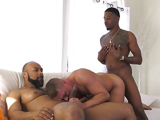 Black hunks fuck a white male coupled with jizz him pertinent